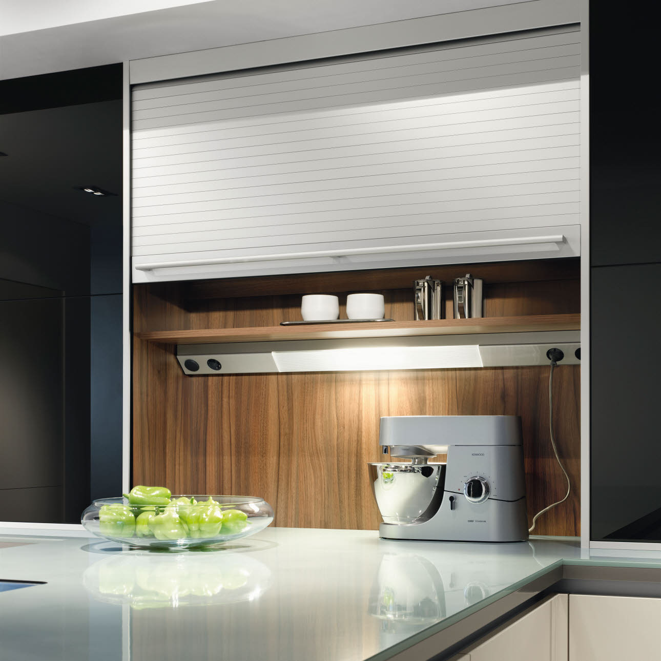 Stainless steel coloured niche light with fluorescent strip and integrated socket