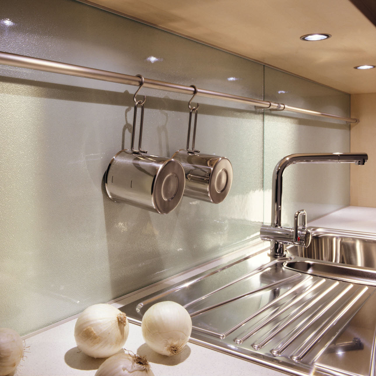 Flush-mounted sinks attached from above