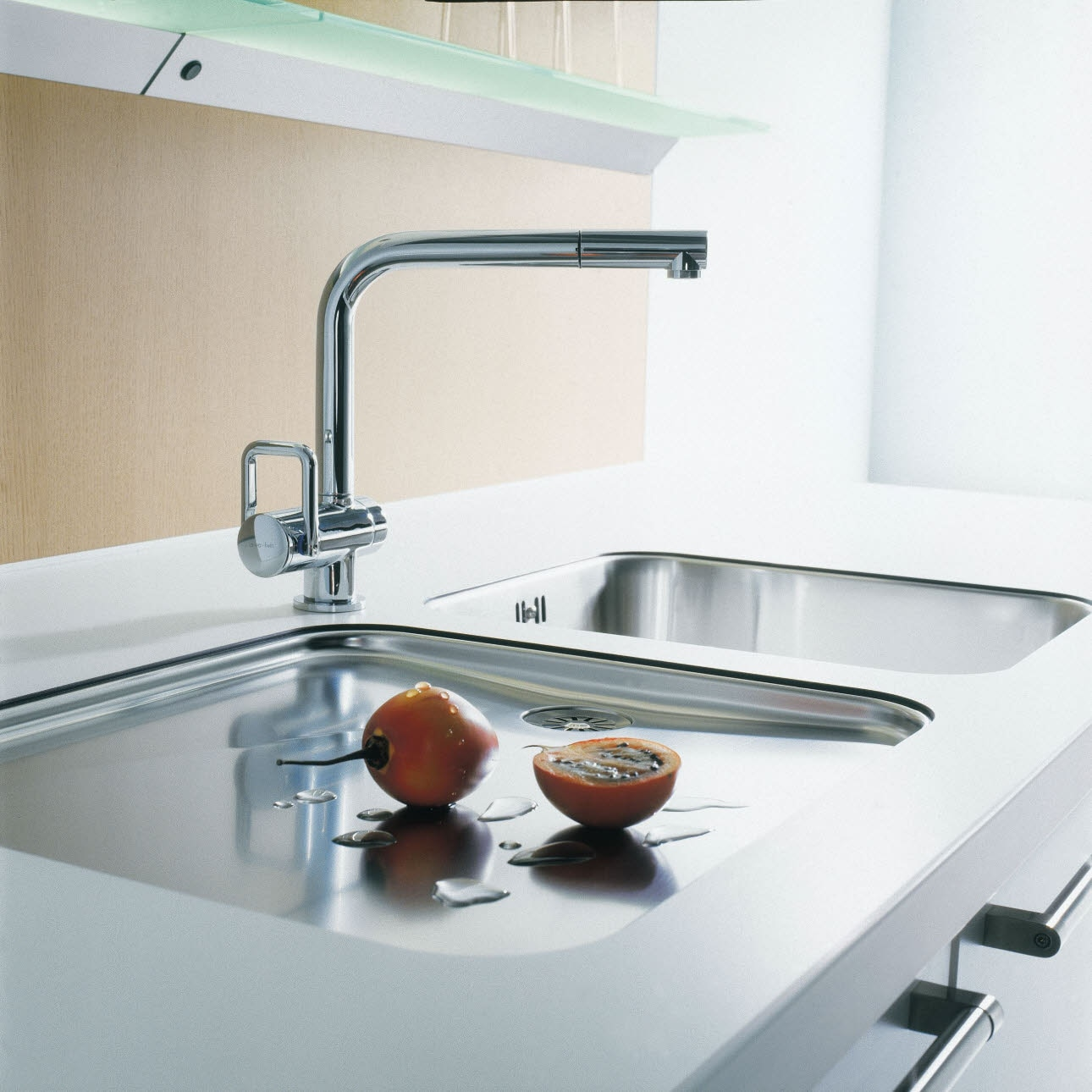 Flush-mounted sinks attached from below